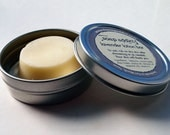 lavender solid lotion bar with travel tin