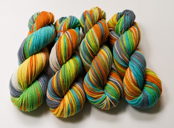 Squishy Face on four 4ozs skeins of Willow Merino - Trim may be ordered separately.