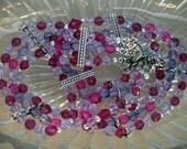 Purple, pink, fuschia crystal beaded necklace multi strands