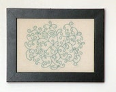 Mint green embroidered scrollwork wall art framed