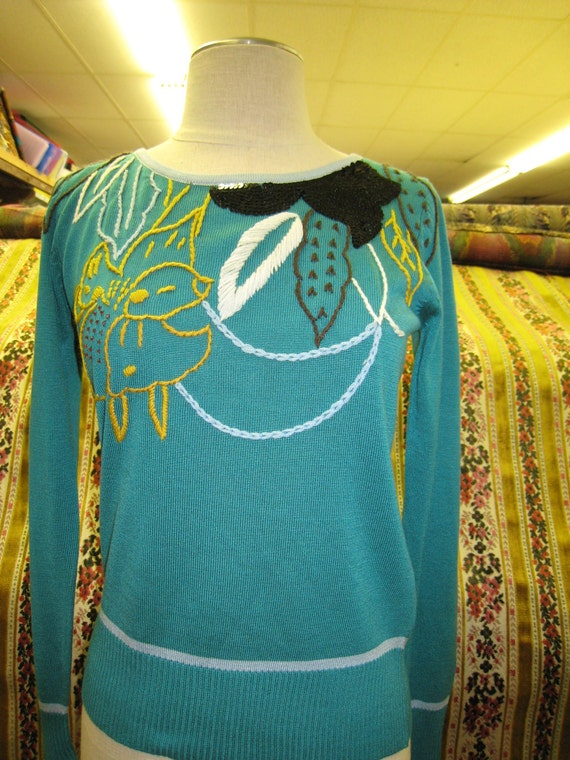 Turquoise color light weight sweater with sequined embroidery decoraiton and made in USA (c50)
