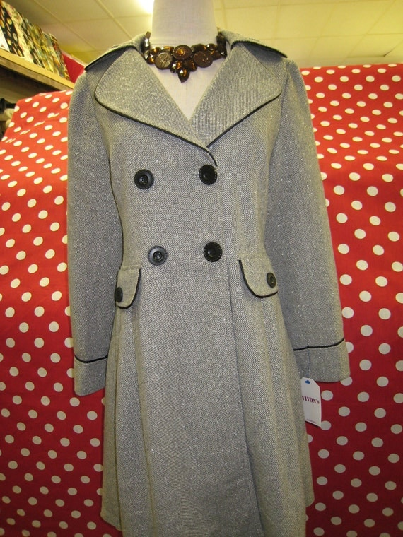 Light gray color coat with buttons up front and two faked packets decoration ( c57)