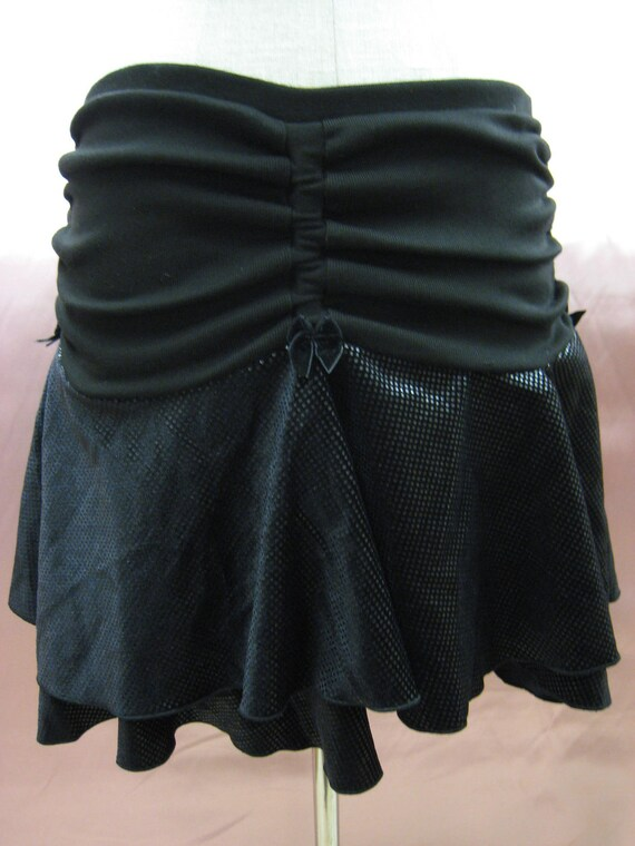 Black color mini skirt with gathered design AND has two layers plus made in USA