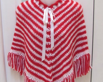 GIRL'S  PONCHO:  Red / White, hand knitted in acyrlic yarn with draw string neckline of satin ribbon