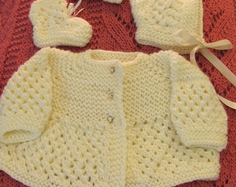 BABY LAYETTE, Hand knitted,in a creme colored, soft yarn for a size 6 months to one year infant