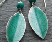 Enamel earrings in fine silver and green enamel, leaf.