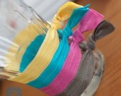 NEW ITEM..Snag Free Hair Ties. Set of 4. You choose your own color from 18 gorgeous color selections.