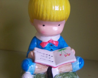 Joan Walsh Anglund figurine paperweight - little boy with yellow hair reading a book - vintage 1972 JAPAN
