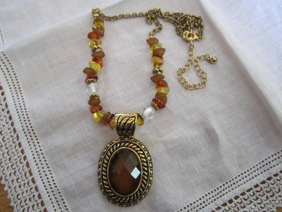 Vintage Gold Tone Avon Necklace with Glass Stones on Chain and Large Oval Faux Amber Pendant