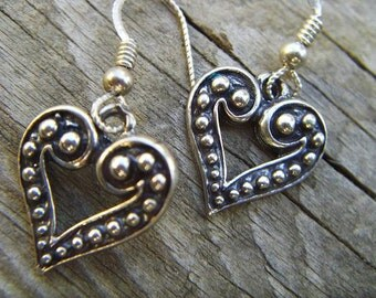 Antiqued heart shaped earrings in sterling silver