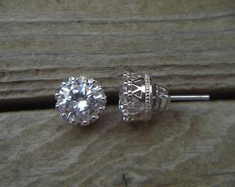 CZ stud earrings in sterling silver set in a fancy crown bezel