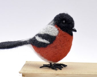 Handmade felted wool bird bullfinch