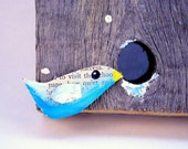 Peek - bird in the snow multimedia --- vintage paper bird looking into a knothole from recycled barn wood