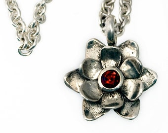 "silver pendant with garnet, peridot, or amethyst. ""succulent in bloom"""