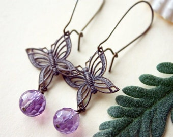Faceted amethyst and brass butterfly earrings
