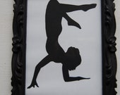 framed yoga silhouette - scorpion pose - vrschikasana with variations