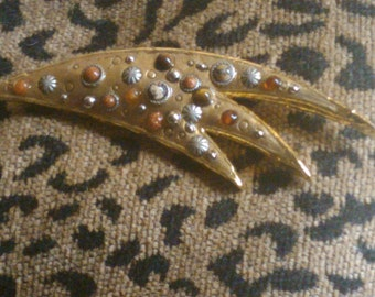 vintage gold pin brooch with stones has a very unusual  abstract shape
