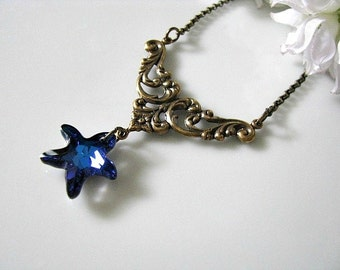 Antique Brass Bronze Necklace With Swarovski Bermuda Blue Starfish Crystal And Leafy Floral Filigree