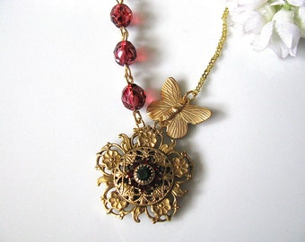 Vintage Swarovski Crystal Flower in Red & Green With Raspberry Tortoise Czech Glass Faceted Rounds And  Brass Butterfly Necklace