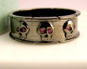 Black skull ring, charcoal grey skull band, ruby gemstone eyes, black gold wedding band, wide wedding ring, statement ring, unique ring