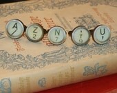 vintage adjustable ring with typewriter letters