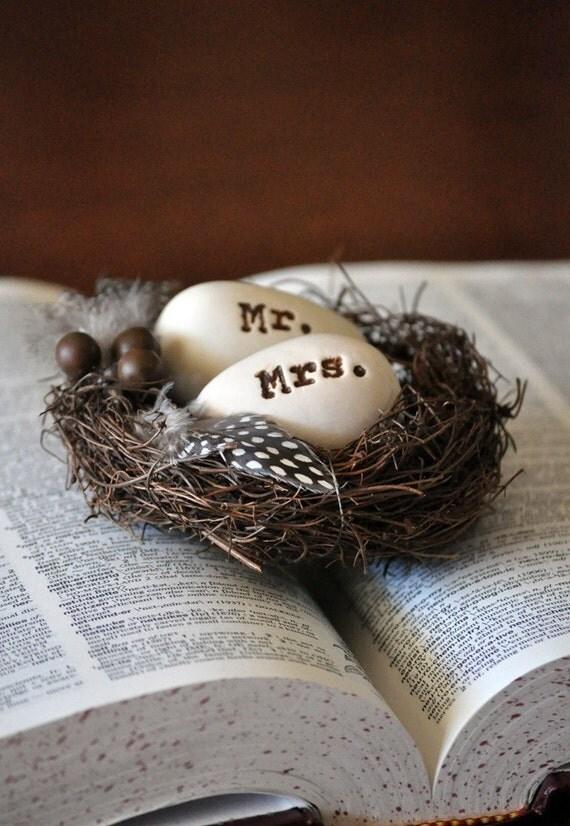 Ivory eggs in a dark brown nest 4 inch