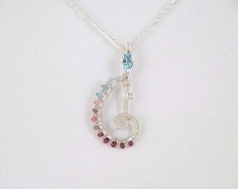 Swiss blue topaz, pink tourmaline, and garnet sterling argentium silver wire wrap pendant