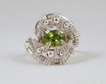Faceted peridot and sterling argentium silver wire wrap ring