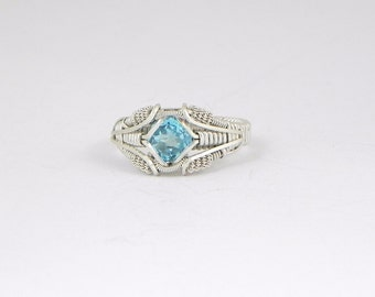 Faceted Swiss Blue Topaz Argentium Sterling Silver Wire Wrap Ring
