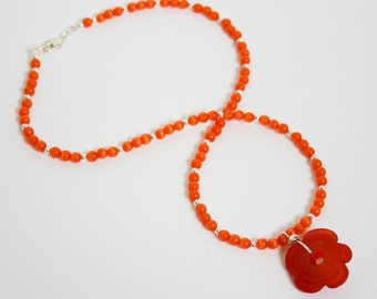 Tangerine cat's eye necklace with bright red flower pendant
