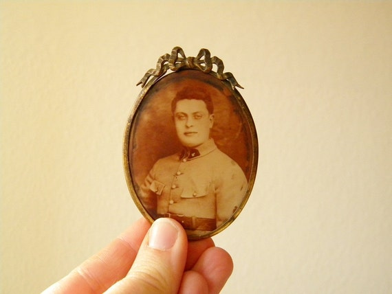 antique small metal frame with photo