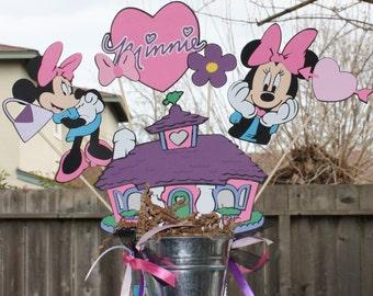 Minnie Mouse party centerpiece for a child's party personalized with age and name