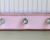 Glass Doorknobs (5) on Distressed Pink Wood