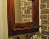 Entry wall Dillon mirror made with solid hardwood  maple 3 brass key hooks, and a mahogany finish