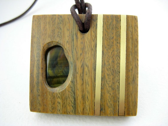 Items similar to wood pendant with stone and brass accents