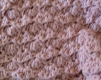 Crocheted shell stitch rose colored baby afghan or lap robe