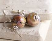 Earrings. Swirled Pink and Tan Lampwork Style Glass with Silver-Plated Accents on Silver-Plated Earwires.