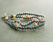 Bracelet. Handwoven St Petersburg Chain. Peach Freshwater Pearl. Green, Purple, Peach.