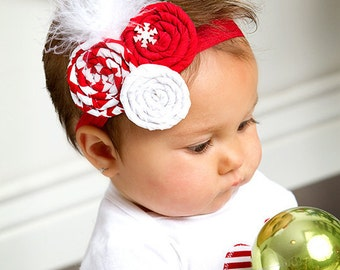 Red and white rolled fabric rosette w/white feathers newborn baby infant girl toddler on a red shimmery elastic headband