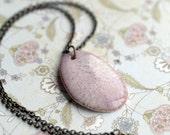 The depth of pink.  Porcelain pendant with mottled pink glaze.