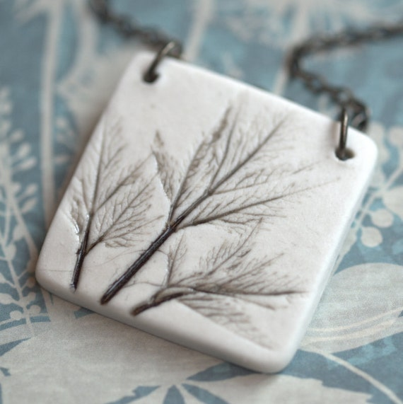 Earthy Porcelain Pendant with Impression of small leaves.