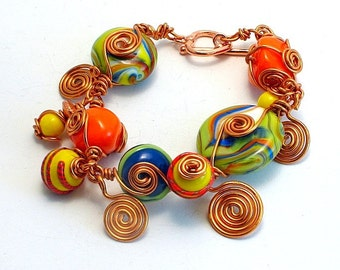 Multi color wire wrapped lampwork bracelet