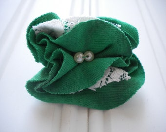Green Cloth with White Lace Rosette Pin