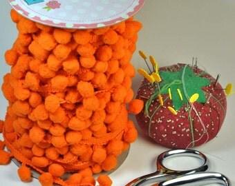 Riley Blake regular pom pom in orange - by the foot