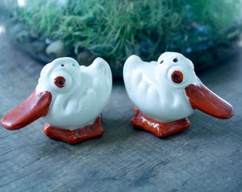 vintage PELICAN salt and pepper shakers