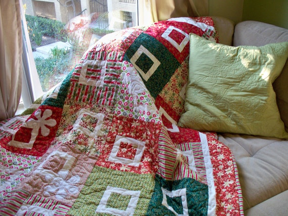 Christmas Quilt or Holiday Quilt with Snowflake Applique in traditional holiday colors