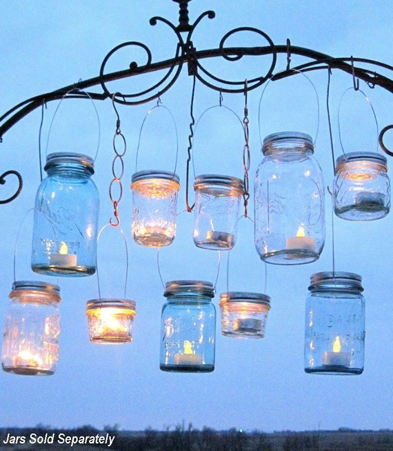 Hanging mason jars lids 14 diy hanging lantern lids reserved for Hanging candles diy