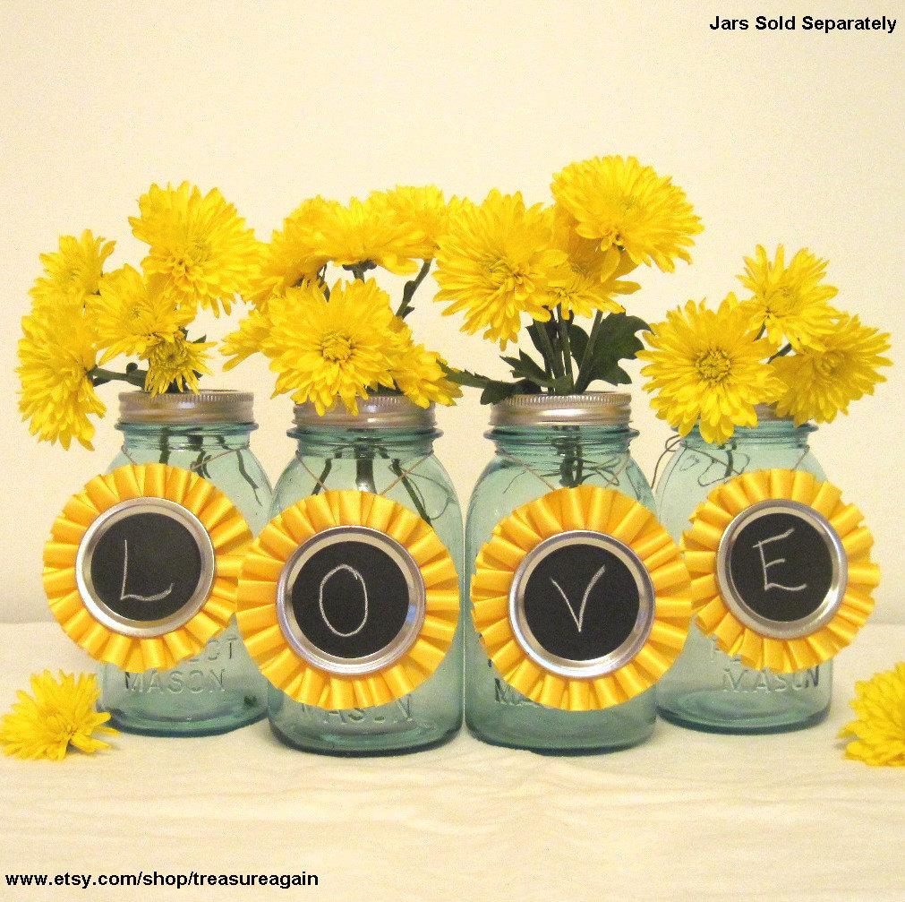 Yellow chalkboard tags ball mason jar centerpiece by