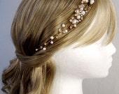 Cream freshwater pearls, cluster of crystal rhinestone flowers, swarovski crystals, soft wire headband perfect as bridal heirloom