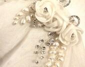 Organza fabric flowers , freshwater pearl vines, crystal rhinestones in settings silver wire brooch